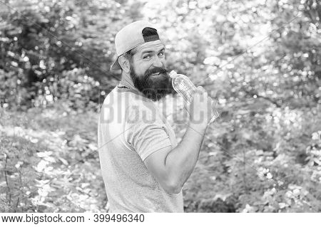 Hydrate Or Die. Brutal Hipster In Forest. Discover New Places. Time For Picnic. Guy Drink Water. Mat