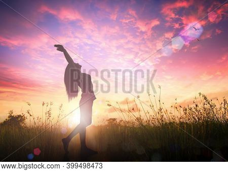 World Mental Health Day Concept: Silhouette Of Healthy Woman Raised Hands For Praise And Worship God
