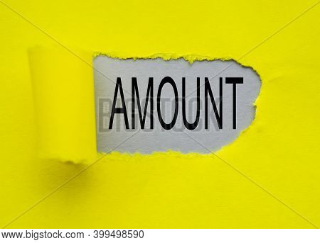 Torn Yellow Paper With A Hole, With The Word Amount On A Gray Background, The Amount Of Salary At Th