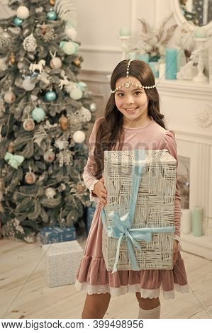 Winter Decorations. Magical Atmosphere. Boxing Day. Open Gift. Winter Wonderland. Adorable Girl Hold