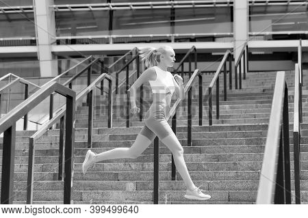 Run Like Beast, Look Like Beauty. Energetic Woman Run At Stadium. Fast Run. Fit Athlete In Sexy Spor