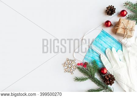 Christmas Composition With Face Masks, Gloves And Decorations On White Background. Coronavirus Chris