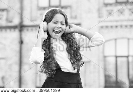 Child Has Music Break. Girl In Headphones. Pretty Little Girl Wear Classy Uniform. Back To School. M