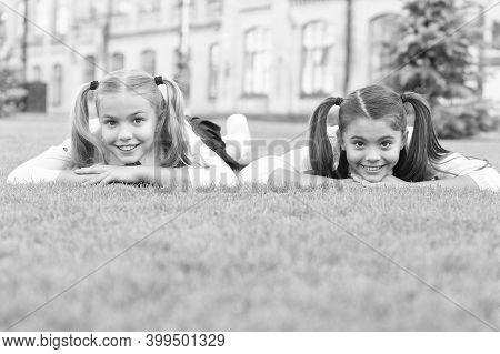 Great Place To Receive Care. Happy Children Relax On Green Grass. Skin Care Products. Summer Skincar