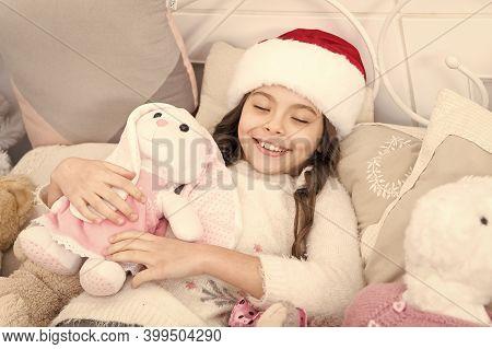 Her Sleep Is So Sweet. Sleeping But Beauty. Happy Child Smile In Sleep. Little Girl Sleep On Christm