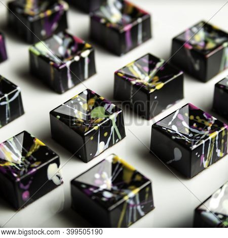 Luxury Chocolate Handmade Candy Bonbons With Ganache Decorated With Colorful Abstract Art On White B