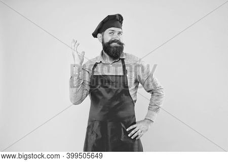First-class Catering. Chef In Restaurant Kitchen. Mature Male Chef At Yellow Wall. Man Cooking On Ki