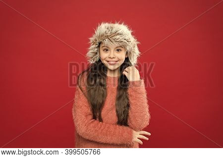 Warm Hat For Cold Winter Weather. Kid Girl Red Background. Soft Furry Accessory. Winter Season. Shop