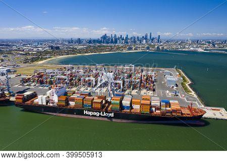 Melbourne, Australia - Dec 9, 2020: Aerial Photo Of Cargo Terminal And Melbourne Cbd