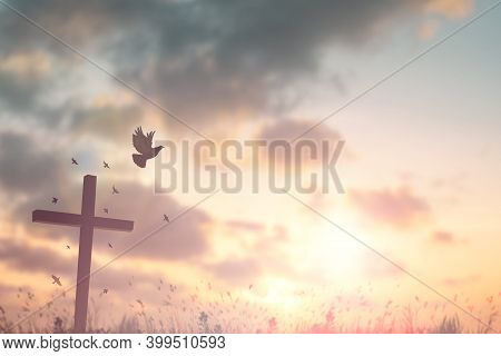 Silhouette Jesus Christ crucifix on Cross In Sunset Good Friday Risen In Resurrection Sunday Easter