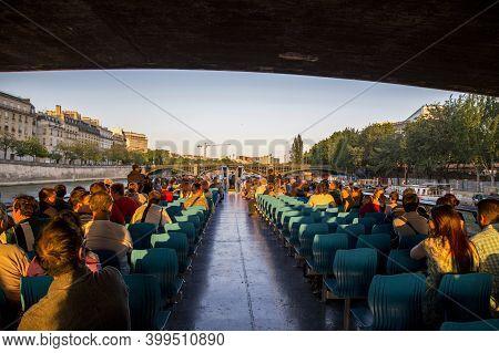 Paris, France - June 07, 2013: People Swim Under The Bridge On A Pleasure Boat On The Seine River In