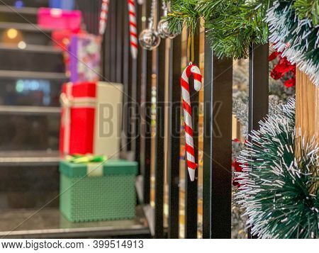 Stairs Handrail With Snowy Garland And Christmas Gift For Christmas Decoration