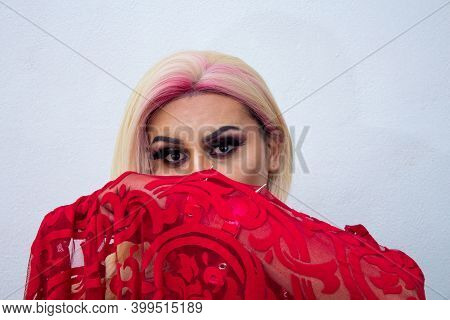 Portrait Of Transgender Behind Cloth Wearing Exotic Drag Queen Costume. Transsexual