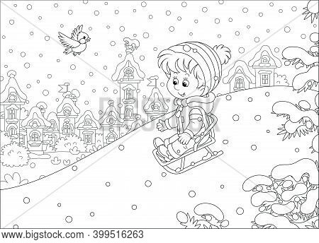 Happy Little Boy Sledding Down A Snow Hill On A Playground In A Snowy Park On A Beautiful Frosty Day