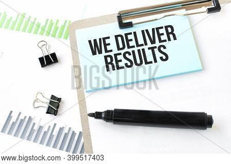 Paper Plate,marker, Diagram,chart And Office Tools. Text We Deliver Results