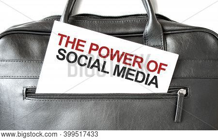 Text The Power Of Social Media Writing On White Paper Sheet In The Black Business Bag. Business Conc