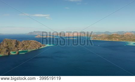 Aerial View Tropical Islands With Blue Lagoons, Coral Reef And Sandy Beach. Palawan, Philippines. Is
