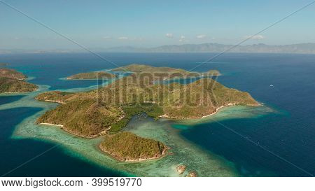 Aerial View Tropical Islands With Blue Lagoon, Coral Reef And Sandy Beach. Palawan, Philippines. Isl