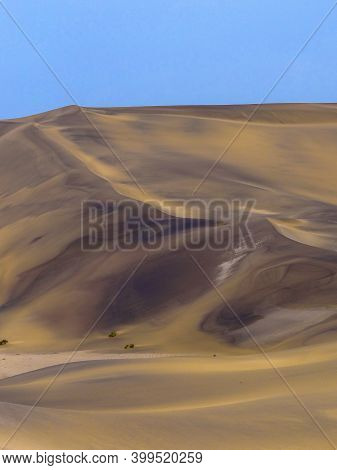 Photograph Of A Sand Dune In The Namib Desert Near Swakopmund, Namibia On A Sunny Dry Season Morning