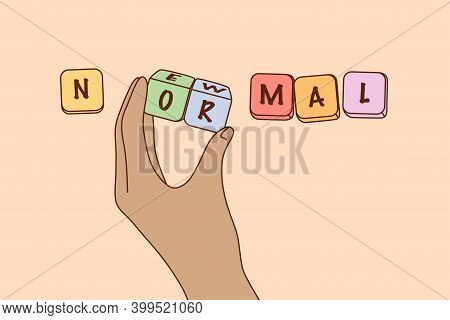 New Normal Reality After Epidemic Concept. Human Hand Forming New Normal Lettering From Colourful Wo