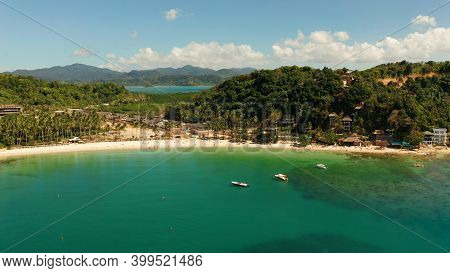 Seascape With Sandy Beach And Blue Water. Seascape With Sea, Sand, Palm Trees. Las Cabanas, El Nido,