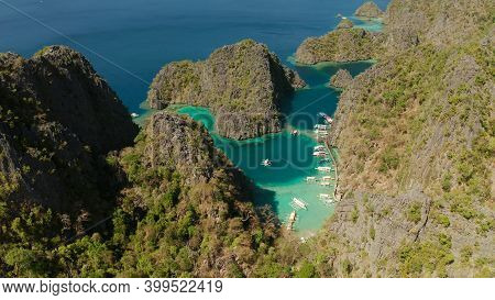 Aerial View Tourist Boats In Lagoons. Kayangan Lake. Lagoons, Mountains Covered With Forests.coves W