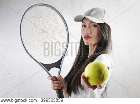 portrait of young asian tennis player