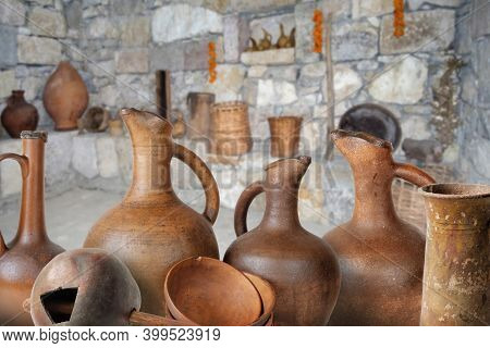 A Set Of Traditional Georgian Wine Jugs And Clay Cups In Marani (cellar For Storing Wine In Special