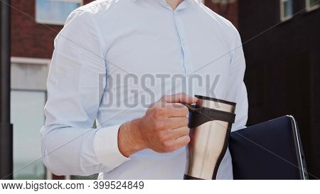 Young and attractive freelancer walking outdoor. Office worker or businessperson. Business and real estate.