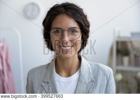 Portrait Of Happy Self Employed Woman Satisfied With Successful Startup