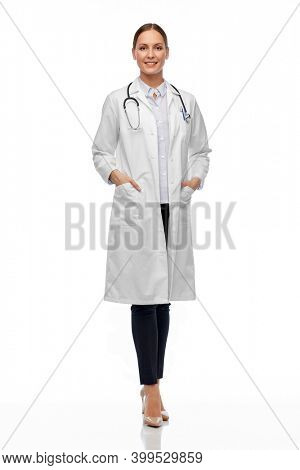 medicine, profession and healthcare concept - happy smiling female doctor in white coat with stethoscope