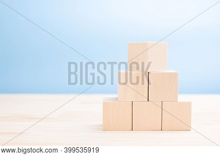 Mockup Image. Pyramid Of Blank Wooden Cubes For Icons, Symbols, Or Text. Business Concept. Wooden Cu