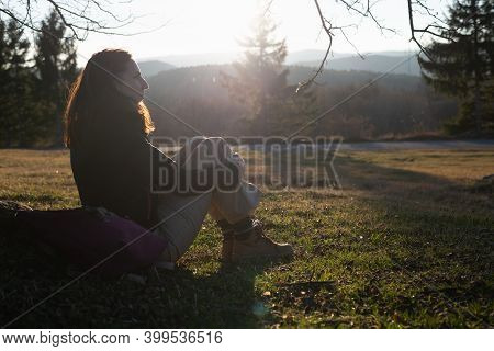 Woman In Nature In Sunset. People In Nature. Beautiful Woman Relaxing In Nature In Sunset. Beautiful