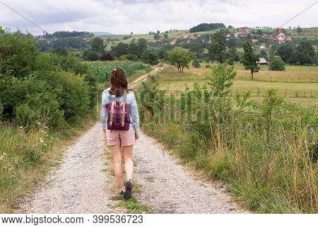 Beautiful Woman Walking In Nature. Happy People Lifestyle. Woman Walking In Meadow In Countryside. N