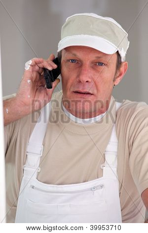 Painter accepting call from customer