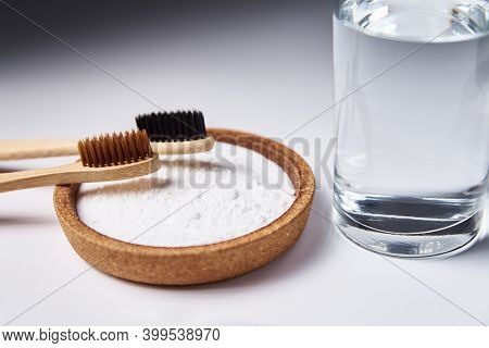 Bamboo Toothbrushes, Baking Soda And Glass Of Water On A White Background. Eco Friendly Toothbrushes