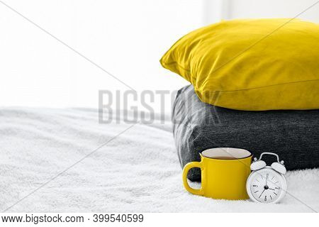 Illuminating Yellow Cup Or Mug With Tea Or Coffee, Ultimate Gray Alarm Clock And Pillows With Colors