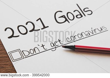 Planner Of Goals And Plans For 2021, A Sheet Of Paper With The Inscription Do Not Get Coronavirus Fr