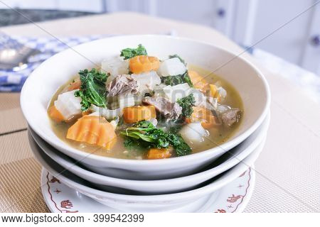 Close Up Of Pork Soup With Mixed Vegetables, Carot, Chines Cabbage, Kale, For Healthy In Asian Count