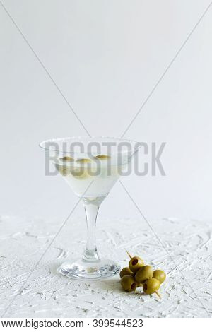 Martini With Olives. Martini Glass With Cocktail And Olives On White Background. Cocktail Margarita