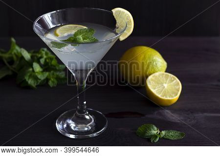 Close-up Cocktail Mojito. Martini Glass With Cocktail And Olives On Black Background. Margarita Cock