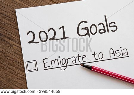 Planner Of Goals And Plans For 2021, A Sheet Of Paper With The Inscription Emigrate To Asia From To
