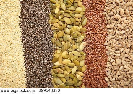 Healthy Superfood: Sesame, Pumpkin Seeds, Sunflower Seeds, Flax Seeds And Chia Background. Seeds On
