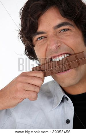 Man eating a bar of chocolate