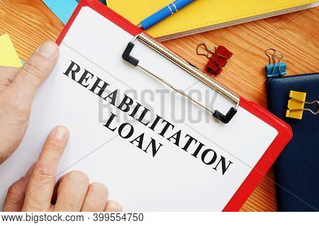 Rehab Or Rehabilitation Loan Application In Office.