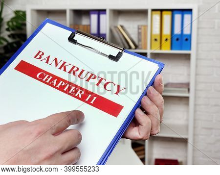 Banker Reads The Chapter 11 Of The Bankruptcy Law.