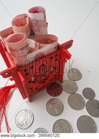Miniature Chinese Pavilion In Bright Red Filled With Chinese 100 Renminbi Banknotes And Surrounded B
