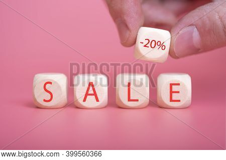 Wooden Cubes On A Pink Background, On Them The Word Sale Is Written