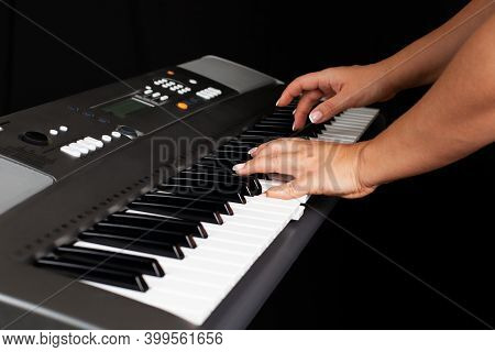 Close-up Of Female Hands Playing A Melody Or Chord On The Keys Of An Electronic Synthesizer, Isolate