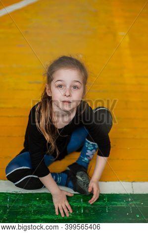 Little Girl Doing Gymnastics. Little Gymnast Girl In Gym. Girl Gymnast In The Gym. Sport.